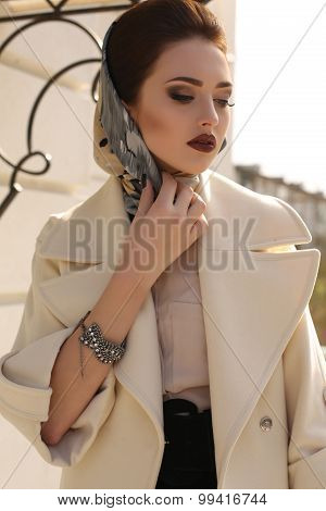 Beautiful Woman With Dark Hair In Elegant Coat And Silk Scarf