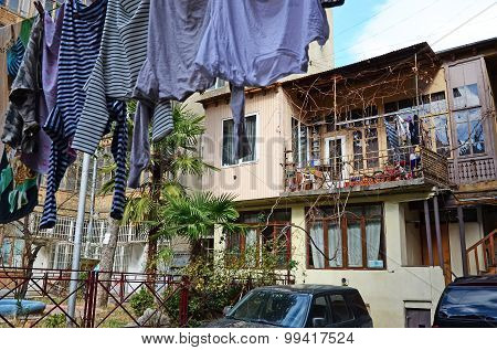 The courtyard of an apartment house with hanging laundry. Tbilisi, Georgia