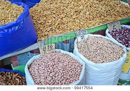 Walnut and various types of beans in sacks. Food market in Tbilisi