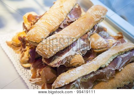 Lot Of Iberian Ham Panini French Bread Sandwiches Stacked Ready To Eat