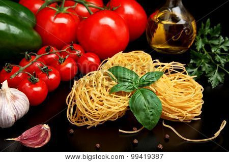 Round Balls Of Pasta With Tomatoes,basil,olive Oil On Black