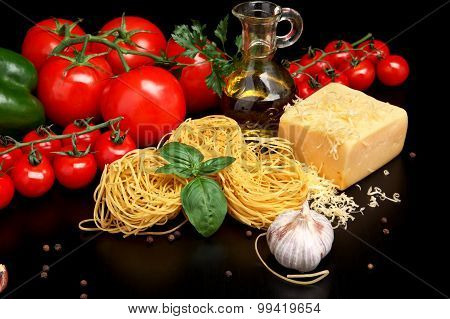 Round Balls Of Pasta With Cheese,tomatoes,basil,olive Oil On Black