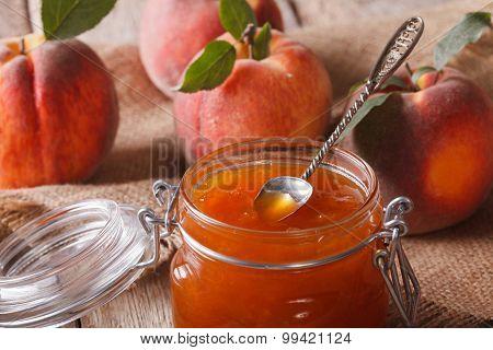 Fresh Peach Jam In A Glass Jar Macro. Horizontal