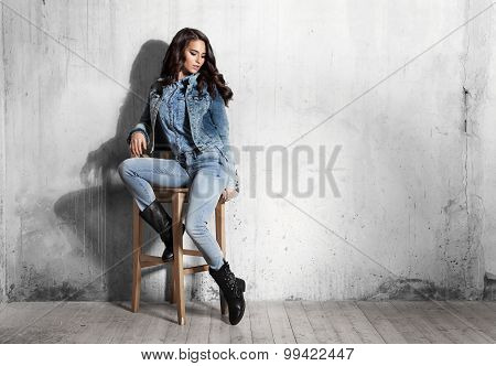 Girl In Jeans Sitting On Wooden Chair