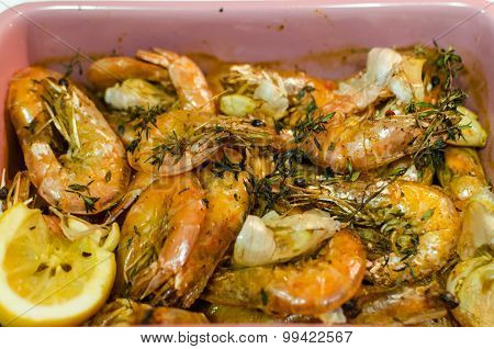 Prepared Roasted Shrimps With Garlic, Thyme Herbs And Lemon Rustic Style