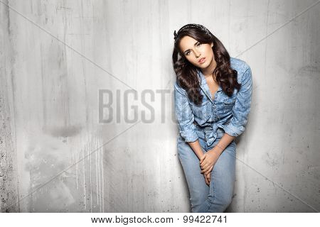Pretty Woman In Jeans Watchig At Camera