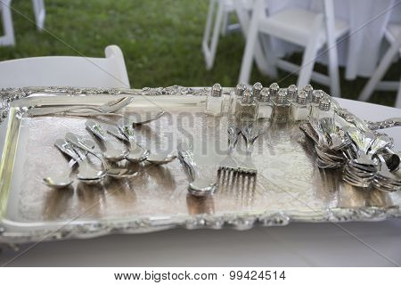 Silver tray with silverware