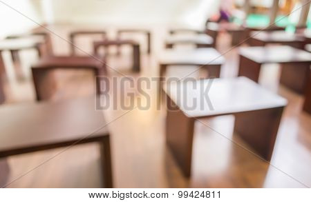 Blur Image Of Wooden Chair In Classroom .
