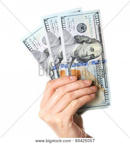 Female hand holding dollars isolated on white