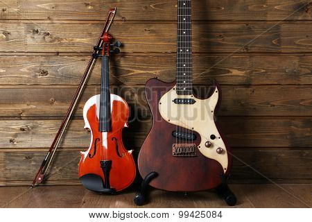 Electric and violin on wooden background