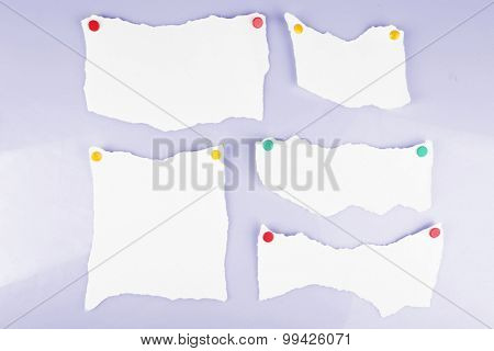 White pieces of paper attached on white background