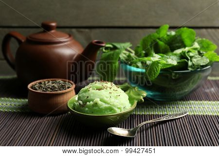 Homemade Green tea ice-cream in cup, on wooden background