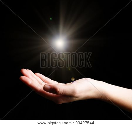 The light in young woman hand