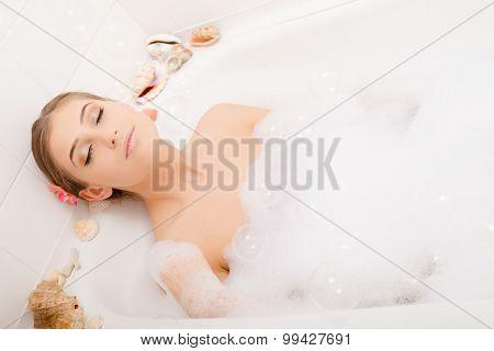 Young lovely woman in foam bath