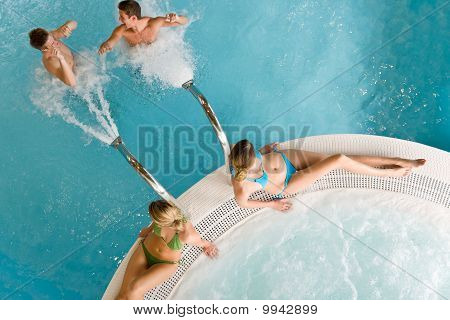 Top View - Young People Relax In Swimming Pool