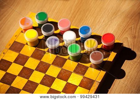 Colourful Watercolor Paint On The Chessboard