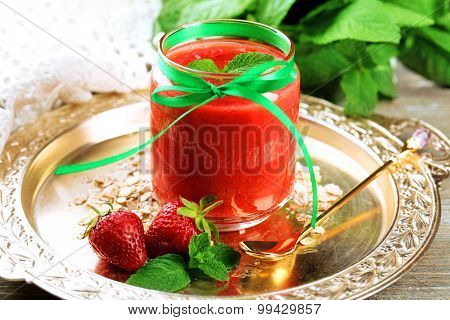 Strawberry smoothie on wooden table background