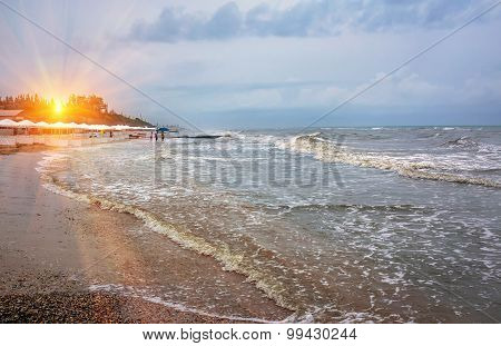 Sunset On The Background Of A Stormy Sea