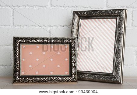 Old frames on wall background