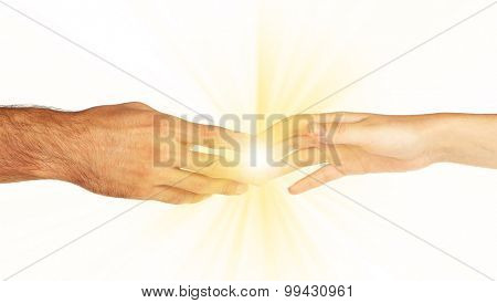 Woman and man hand attracted to each other with light isolated on white