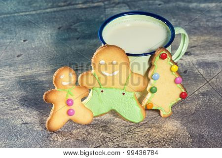 Christmas Cookies And Tin Cup On Wooden