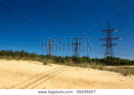High-voltage Line In A Forest With Sand