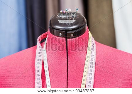 Mannequin With Measure Tapes And Clothes
