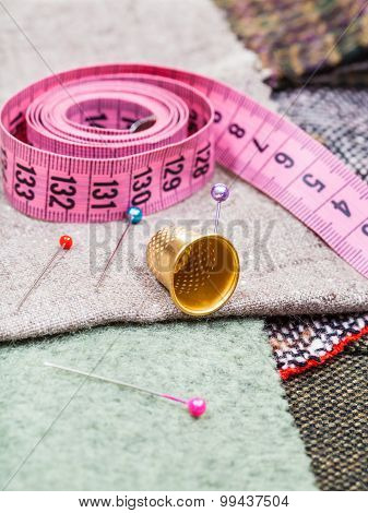 Pink Measuring Tape, Pins, Thimble On Tissue