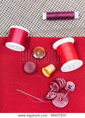 Sewing Thread, Buttons, Thimble On Red Cloth