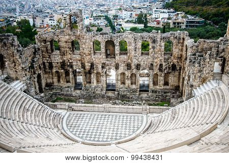 Herodes theater of the Acropolis in Athens with the city of Athens at background