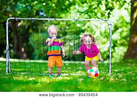 Kids Playing Football In School Yard