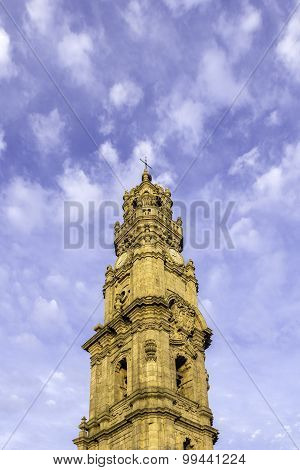 Bell Tower Of The Clerigos Church In Cloudy Blue Sky Background