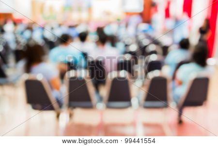 Blurred Image Of People In Auditorium