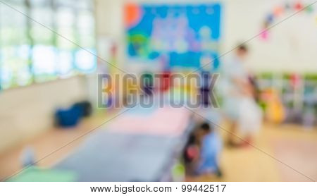 Blur Classroom With Teacher And Kids