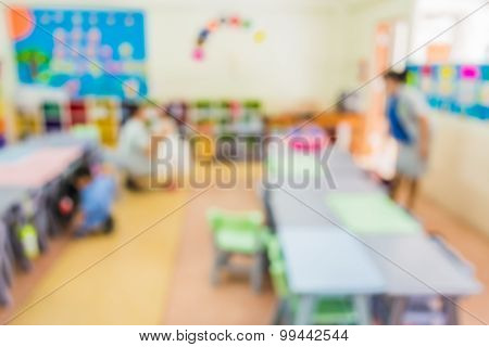 Blur Classroom With Teacher And Kids