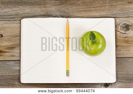 Writing Tools And Snack For School Or Office On Rustic Wooden Boards