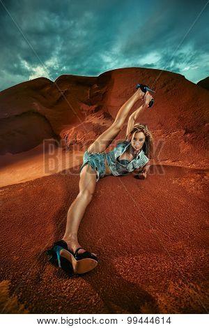 Young attractive woman is doing splits heels over head