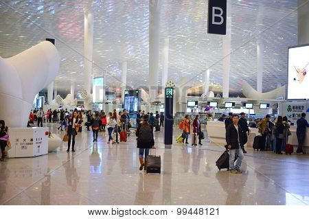 SHENZHEN, CHINA - FEBRUARY 16, 2015: airport interior. Shenzhen Bao'an International Airport is located near Huangtian and Fuyong villages in Bao'an District, Shenzhen, Guangdong