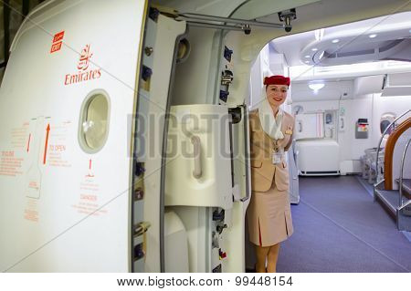 DUBAI, UAE - MARCH 10, 2015: Emirates Airbus A380 crew member. Emirates handles major part of passenger traffic and aircraft movements at the airport.