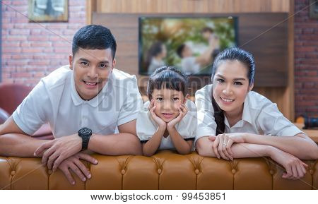 Happy Young Family Wathching Flat Tv