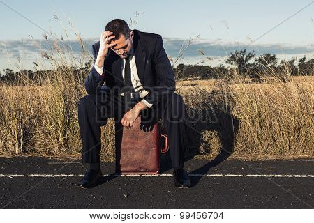 Frustrated businessman in the outback