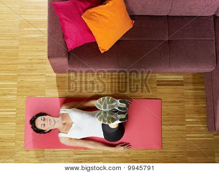 Woman Doing Abs Exercise At Home