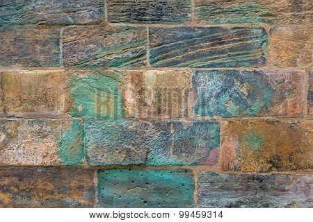 Old wall with turquoise discoloration