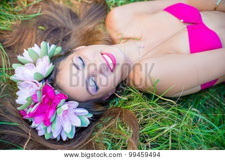Smiling pretty young lady with long hair in wreath