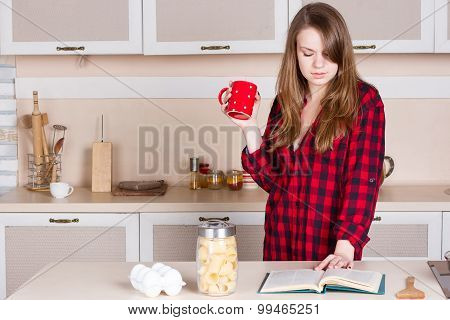 Girl In A Red Mens Shirt. Kitchen With Cup His Hands
