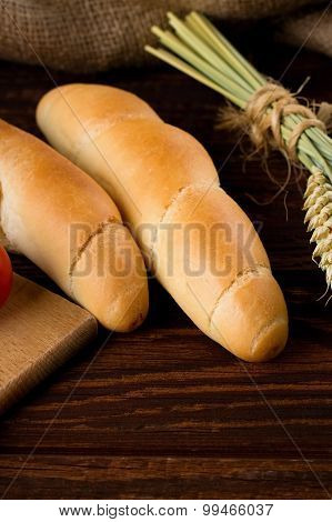 Two Rolls On Wooden Board