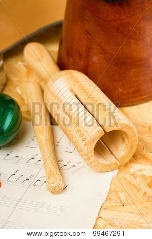 Guiro On Wooden Board And Sheet With Music