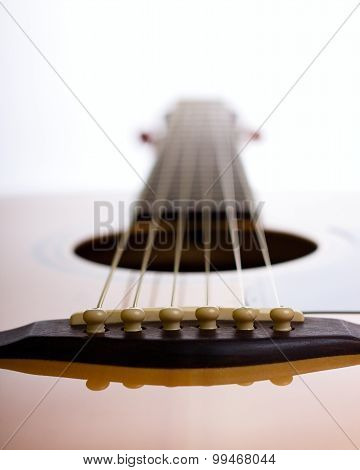 Bridge Of Acoustic Guitar Against Light