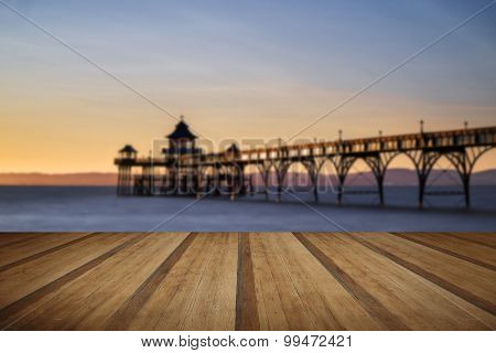 Beautiful Long Exposure Sunset Over Ocean With Pier Silhouette With Wooden Planks Floor