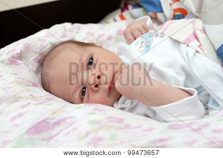 Portrait Of Pensive Newborn Baby